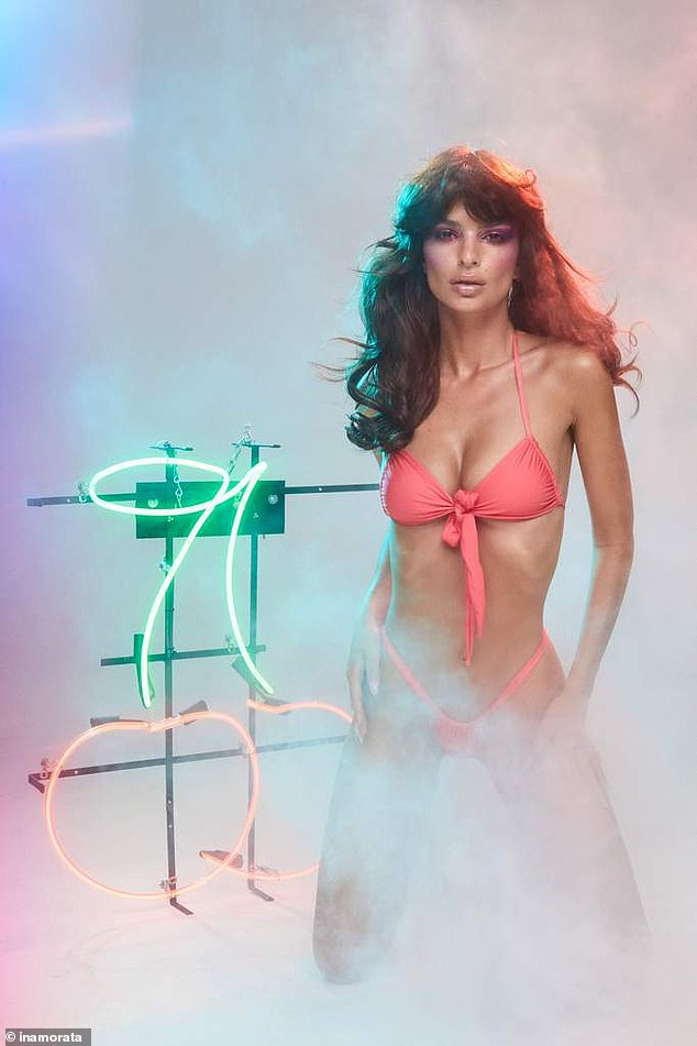 Sizzler: A smoke machine added a bit of mystery to the affair as Emily knelt in front of a couple of neon cherries and pulled her best smoldering supermodel stare