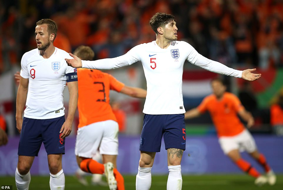 Stones (right) questions the referee after he believed he was fouled during the Holland set-piece from which they scored