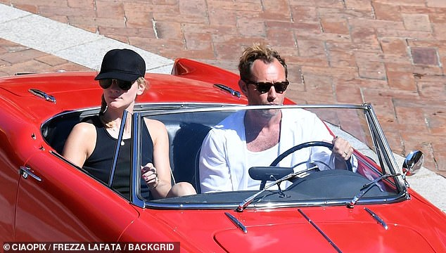 Romantic: Jude Law, 46, and his new wife Phillipa Coan, 32, continued their smitten display during their honeymoon on the Italian island of Sardinia on Thursday