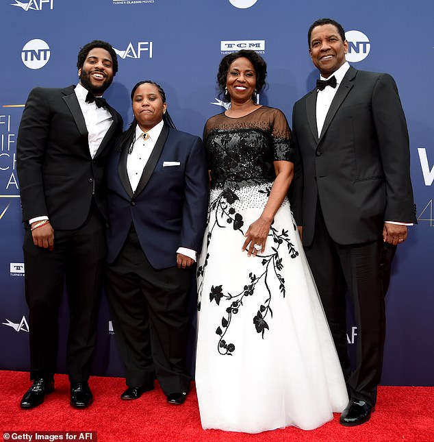 Good husband: Denzel Washington's 'biggest lifetime achievement' is his wife of 35 years, Pauletta, he said before being honored with an AFI award in Hollywood on Thursday