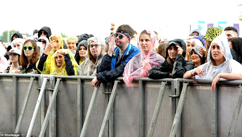 Festival-goers brave the rain at Parklife festival in Manchester as the Met Office issues flood warnings, with rain expected hiot the country at 4am on Monday