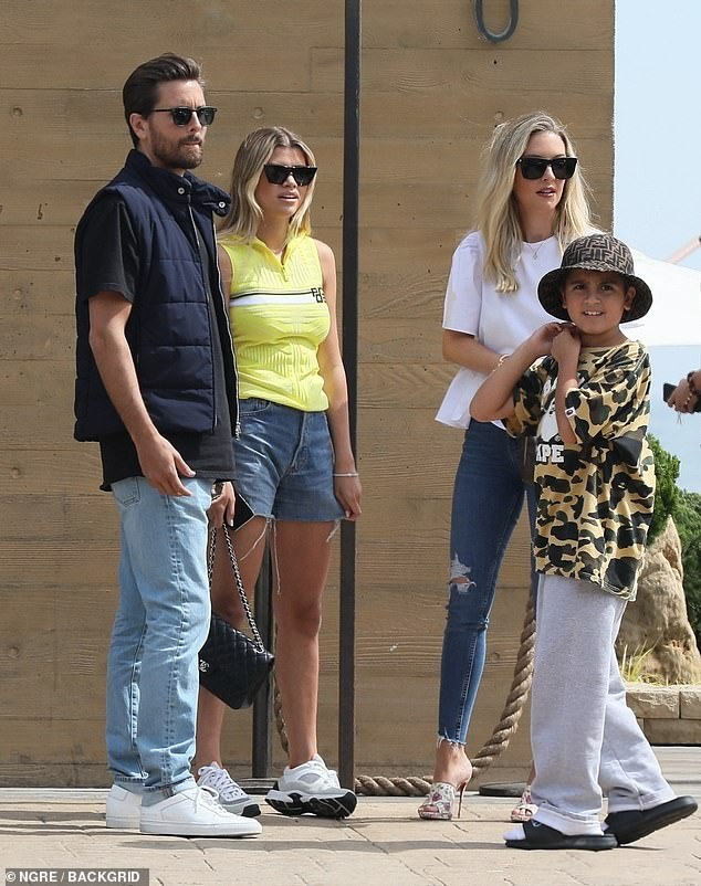 Family time: Sofia Richie and Scott Disick took son his Mason, 10, and a friend out to lunch at the popular Japanese restaurant, Nobu, in Malibu on Monday