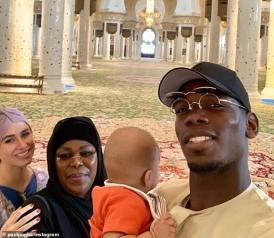 Pogba poses with his girlfriend Maria Salaues, mother Yeo and his firstborn child in Abu Dhabi