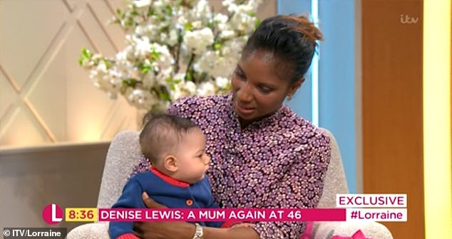 Doting: As Troy say happily on his mum's lap, the tot was on his best behaviour throughout the interview