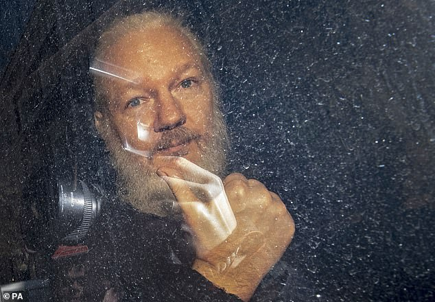 Julian Assange, pictured leaving the Ecuadorian Embassy on April 11, is facing possible extradition to the United States where officials want to charge him for leaking secrets