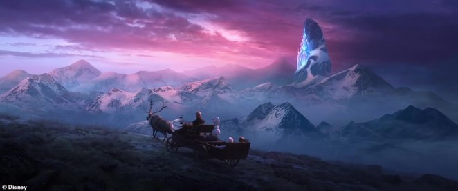 Long journey: Kristoff, Sven and Olaf ride a sled through 'the enchanted lands'