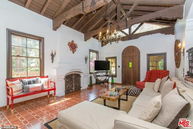 Living room: This view shows the property's bright interior, which in this image has been deocrated with sofas, a coffee table and a TV. It also shows the 1920s villa's exposed wooden ceilings