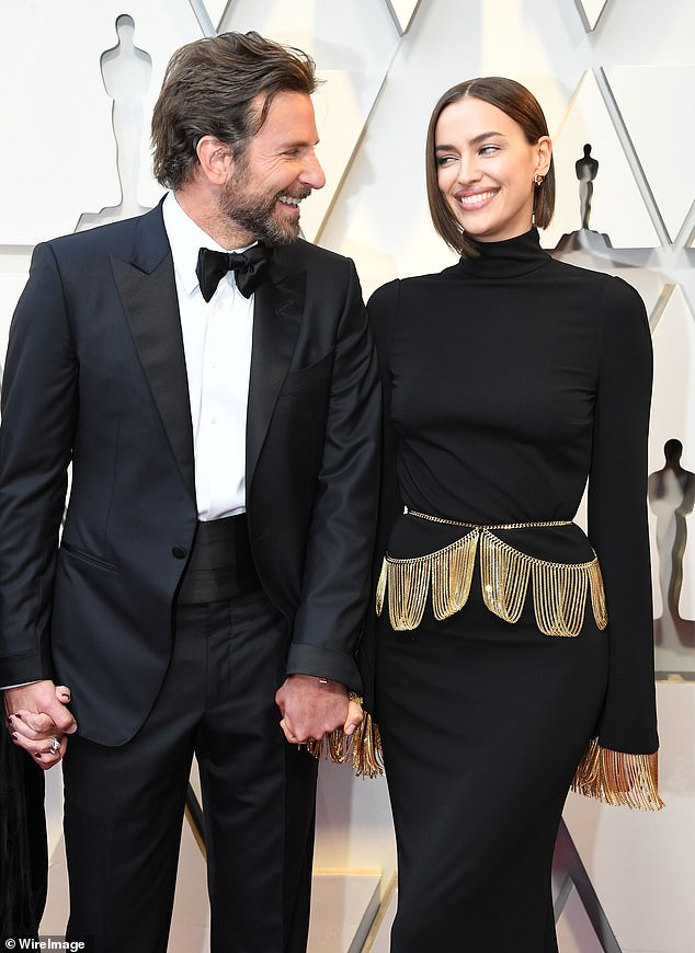 Happier times: 'The rumors about Bradley and Gaga having a love affair didn't help especially with his constant travels [promoting the film],' according to People 's insider; Irina and Bradley pictured on February 24 at the 91st Annual Academy Awards in Hollywood