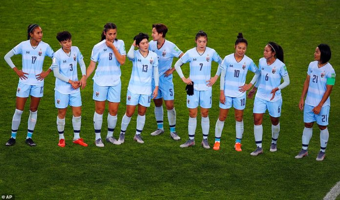 Thailand players react with despair following their 13-0 loss to the United States in their Women's World Cup