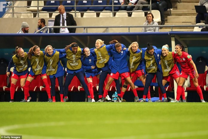 Alex Morgan (right) of United States celebrates with mates after scoring a goal to make it 12-0
