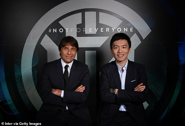 Conte (left) smiles as he is unveiled as the new Inter Milan boss alongside the club's president