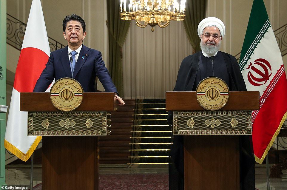 Japan's leader Shinzo Abe (left) speaks at a press conference with Iranian president Hassan Rouhani (right) in Tehran yesterday. Mr Abe warned of an 'accidental conflict' in the region