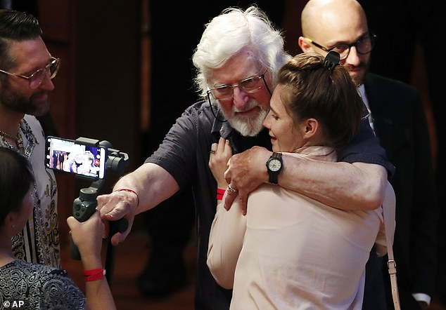 I know how you feel: Amanda Knox hugs the Irishman Peter Pringle, who himself was convicted of murder, at the Criminal Justice Festival in Modena today
