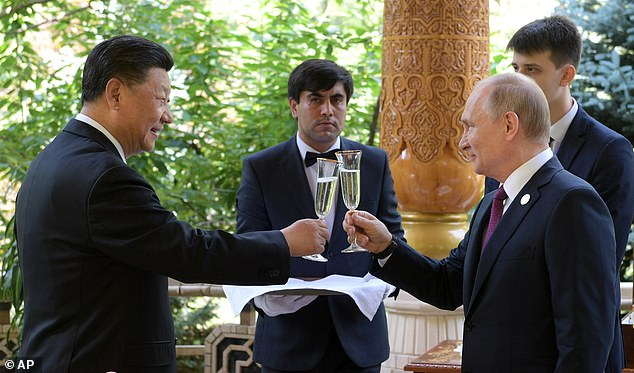 Russian President Vladimir Putin, on the right, met on Saturday with Chinese President Xi Jinping before the conference on interaction and confidence-building measures in Asia