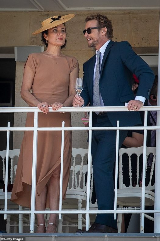 Simon Baker and his wife of 20 years Rebecca Rigg look as ...