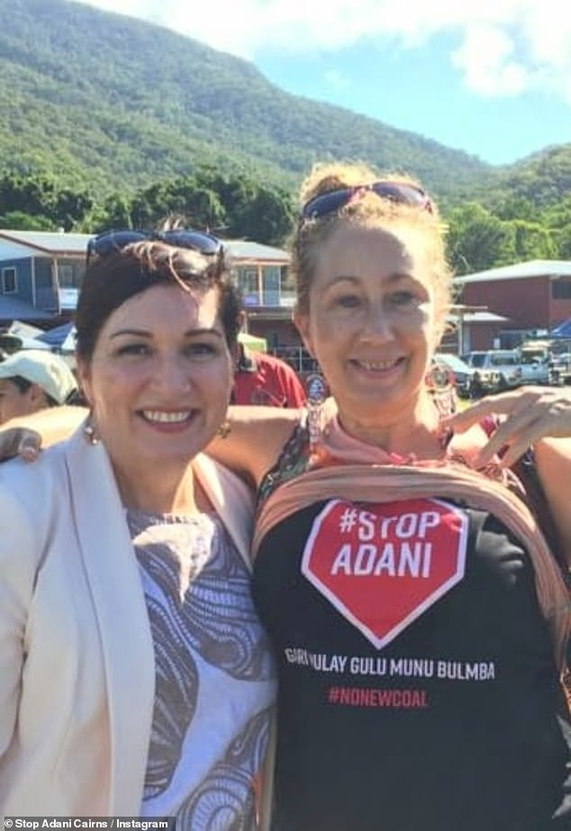 The video post came two days after a photo of Ms Enoch (left) standing next to the same woman (right) who had lifted up her shirt to reveal 'Stop Adani' was posted to the site
