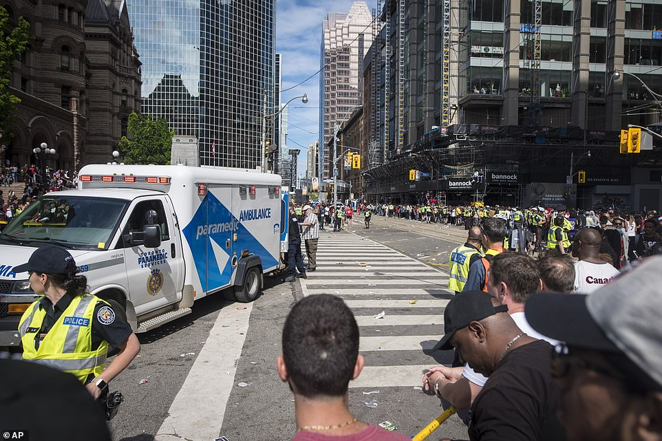 An ambulance arrives to the scene after shots were fired during the Toronto Raptors NBA basketball championship parade