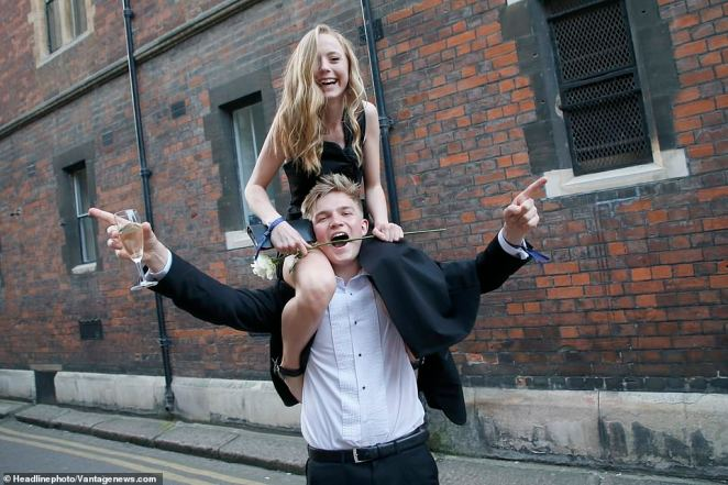 Two students pose for the camera to celebrate the end of the academic year in style, following the biggest event of the Cambridge student social calendar