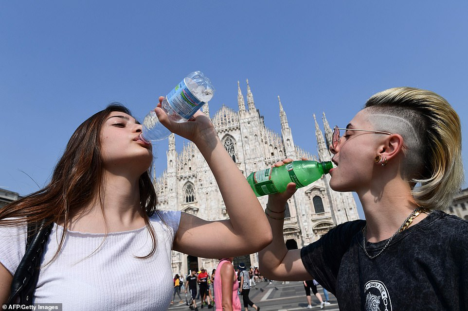 Italy's health ministry, meanwhile, has issued a maximum red alert for heat for six cities on Thursday and for 16 on Friday, Ansa reports. (Above, women drink water in front of the Duomo in central Milan on Wednesday)