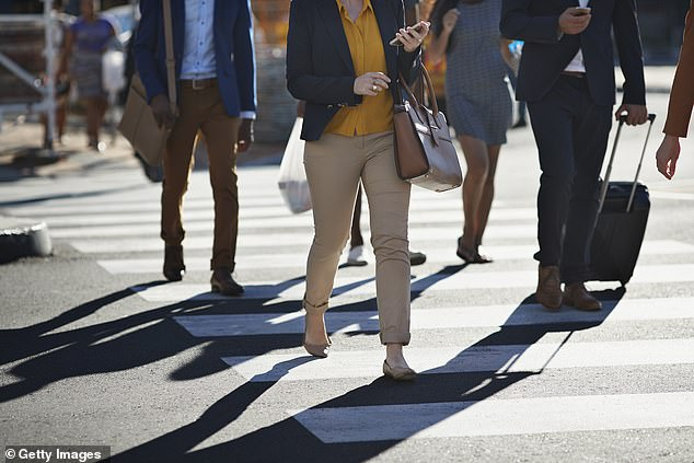 Pedestrians who look at their phones while crossing the road could be fined $200 if a proposal by the Pedestrian Council of Australia gets the green light
