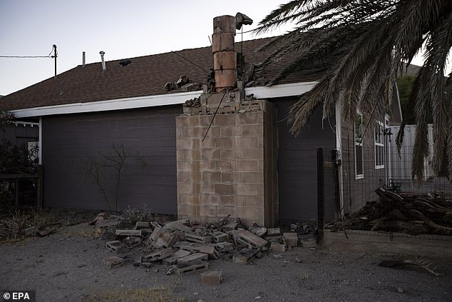 Bricks from a house's chimney sit on the ground in the wake of the tremor in Ridgecrest