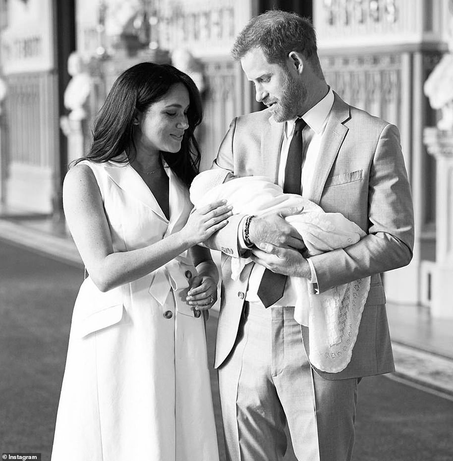 In the second snap the couple look adoringly at their new arrival, named Archie Harrison Mountbatten-Windsor