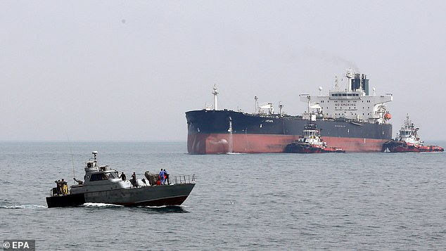 It comes after Iranian Revolutionary Guards boats (pictured front, file image) attempted to seize UK-flagged tanker British Heritage as it passed through the Stait of Hormuz Wednesday