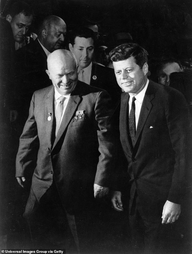 A historian has said that John F. Kennedy (right) was serious when he asked Nikita Khrushchev (left) of the Soviet Union to join forces to send men to the moon in the 1960s