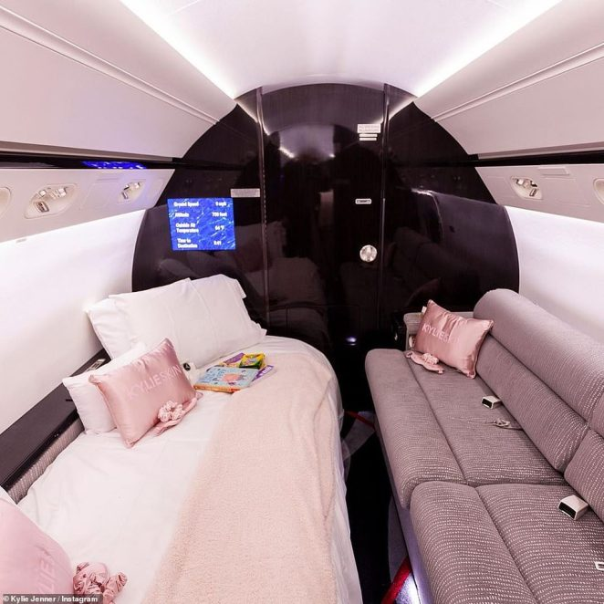 Nice digs:The jet's interior featured plush grey seats with a few pops of pink added thanks to some pink Kylie Skin satin pillows