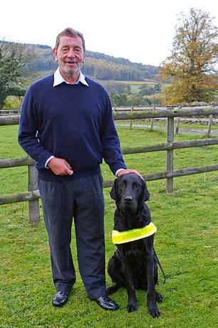 Pictured: Lord Blunkett with guide dog Cosby