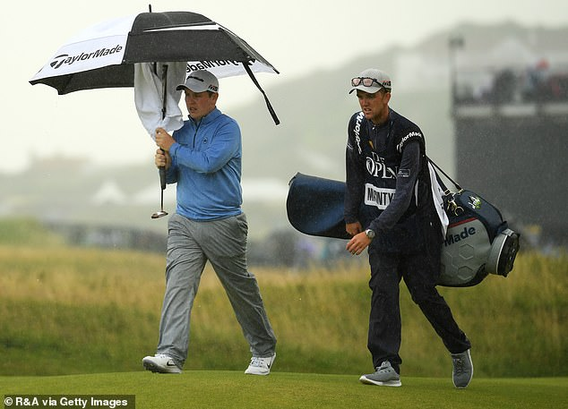 MacIntyre and his caddie Greg Milne (right) were not at all happy with Stanley's conduct