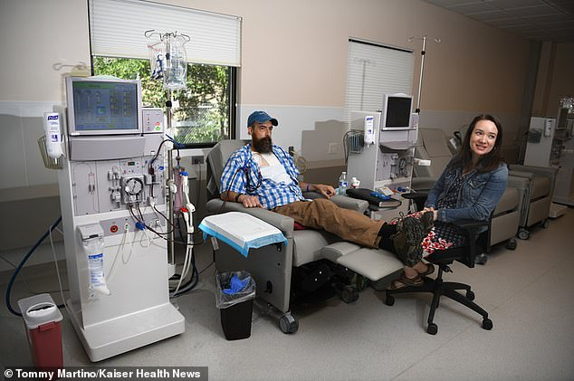 Valentine's wife contacted the state insurance commissioner that there is an in-network dialysis clinic that hadn't appear on the insurance directory. Pictured: Valentine, left, and his wife during a dialysis session