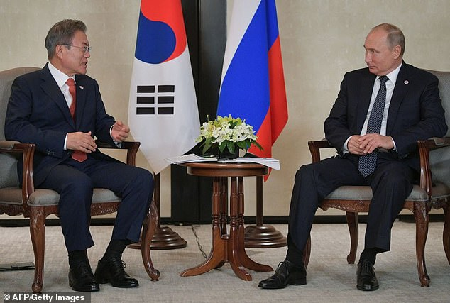 South Korean President Moon Jae-in pictured with Russian President Vladimir Putin in Singapore in 2018