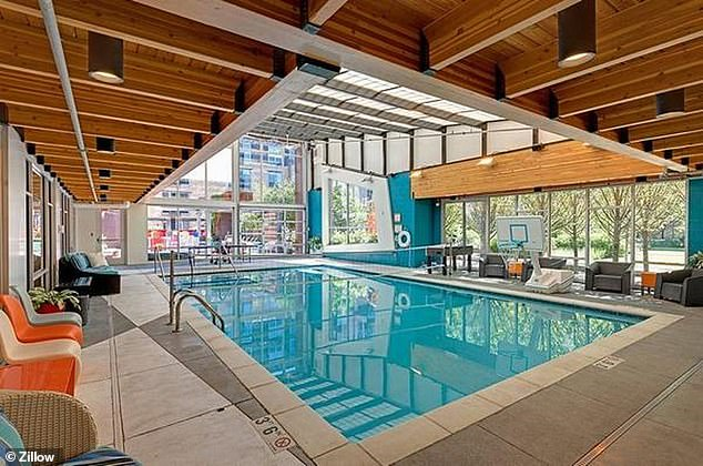 The luxury building also has a sauna, indoor pool (pictured), hot tub and gym