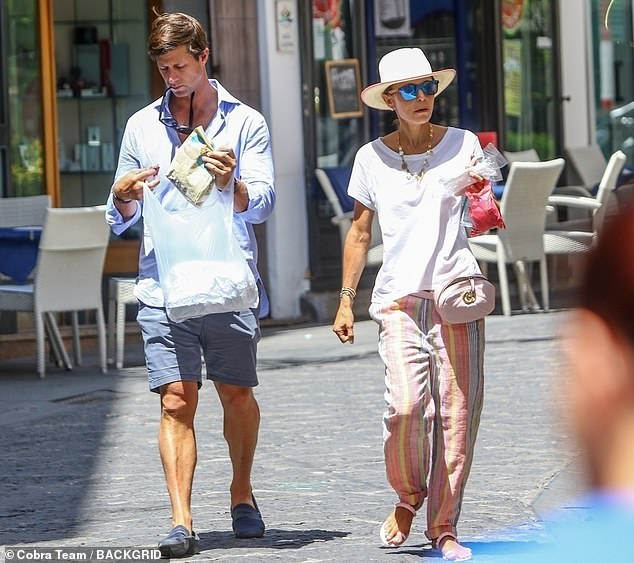 Gorgeous stroll: The happy couple was later spotted out for a stroll on the cobblestone streets as they picked up some lunch for an impromptu picnic