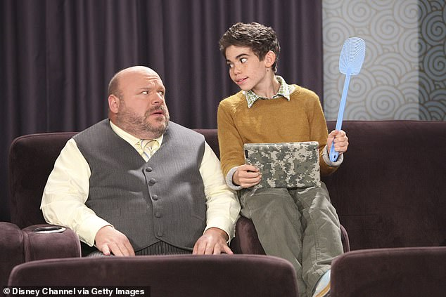 Disney star: Cameron is shown with Kevin Chamberlin in a 2011 still from the Disney Channel series Jessie