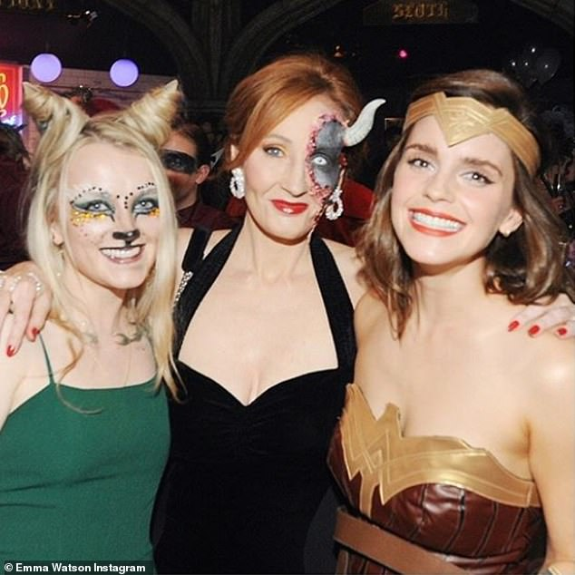 Potter party: Emma Watson (right) dressed as Wonder Woman as she celebrated Harry Potter author J.K. Rowling's (centre) 54th birthday with fellow Potter starEvanna Lynch, who played Luna Lovegood