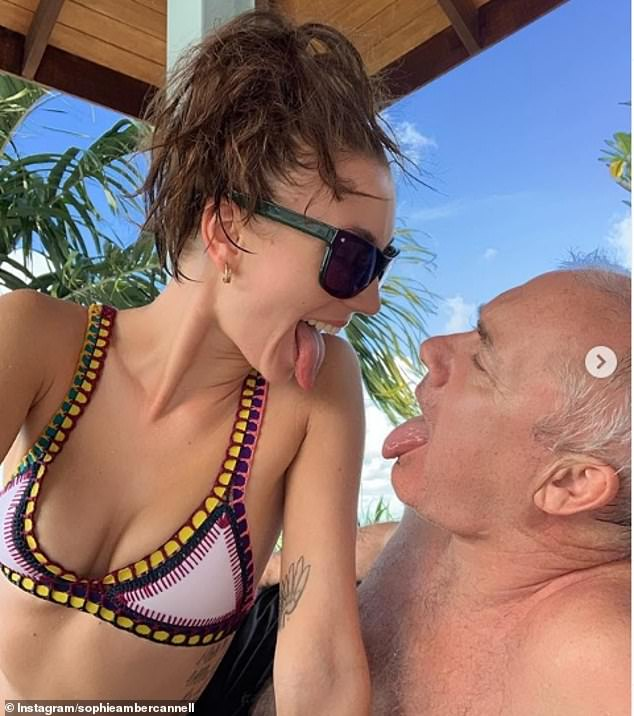 Proud girlfriend: Sophie shared this candid snap of her and Hirst pulling funny faces while celebrating his birthday. She called him 'my love' in the post