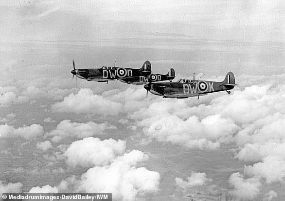 Pictured: One of the most iconic images of the summer of 1940 and the fight above Dunkirk, with Squadron 610's F/Lt Ellis pictured at the head of his section in DW-O, Sgt Arnfield in DW-K and F/O Warner in DW-Q