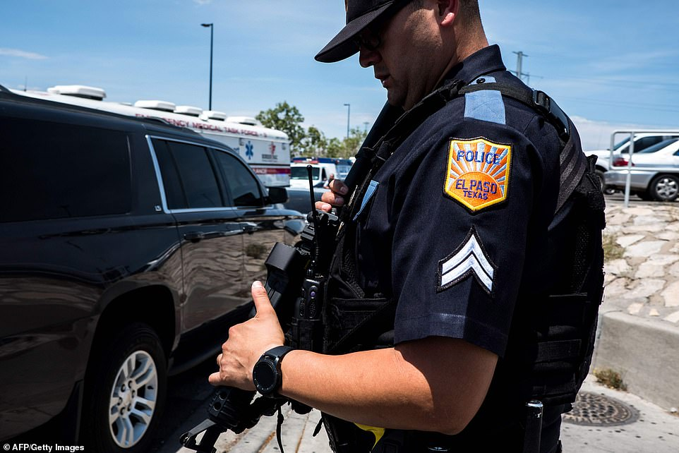 A local police officer is seen near the Cielo Vista Mall in El Paso on Saturday