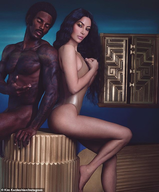 Shrinkage? A photo from October 2018 pictured her sitting on a pedestal next to a nude male model, yet fans detected something was amiss with Kim's derriere, which looked smaller than usual