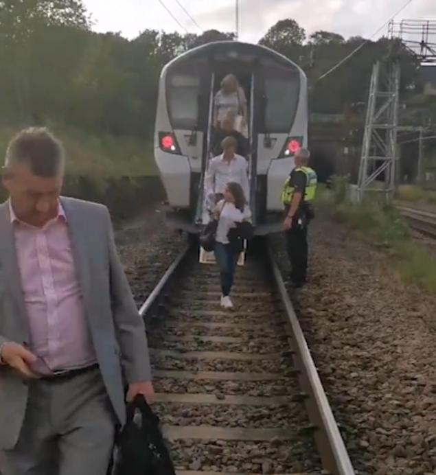 Commuters abandoned a train from Highbury and Islington, after a power outage caused it to stop on the tracks