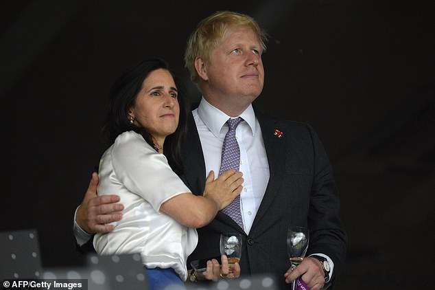 Ms Wheeler split from Johnson last year (the couple are pictured at the opening ceremony of 2012's London Olympic Games