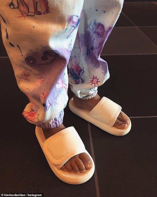 Slides: For one look, she traded out the feather shoes and wore some white, Velcro strap slides