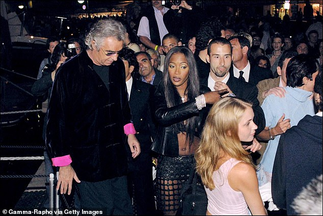 Out of her depth: Earlier that night, the blonde teenager, thought to be Miss Roberts, is photographed awkwardly looking around as the revellers wait to board the yacht. She is standing close to Miss Campbell, Briatore and Miss Maxwell, who is in a light-blue turtleneck