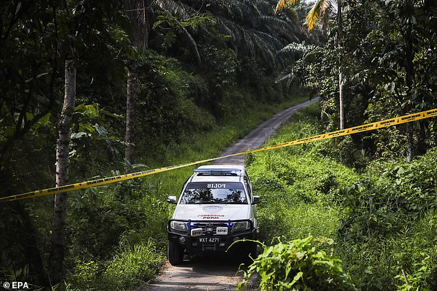 A Royal Malaysian Police forensics truck arrives on the tenth day after teen went missing on August 4