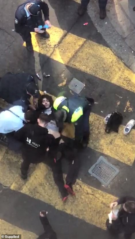 The alleged attacker was pinned to the ground by heroic bystanders. They held him down with milk crates until police arrived