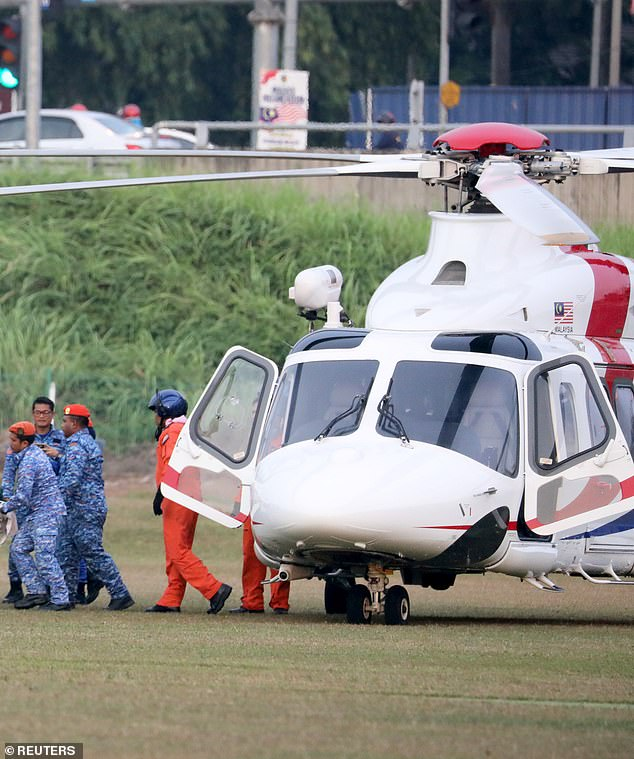 The body of Nora was airlifted to hospital after being winched from the Malaysian jungle