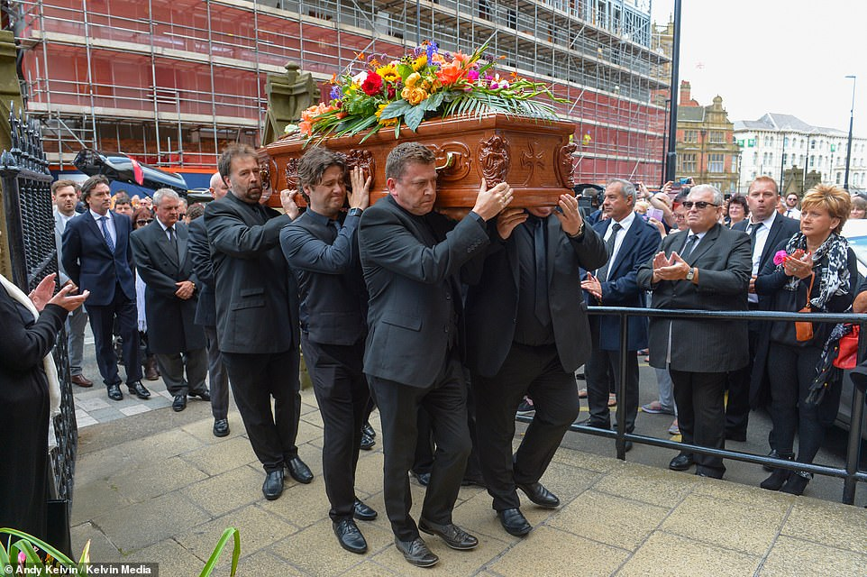 Stars such as Ricky Tomlinson, the Nolan sisters and Jimmy Tarbuck were among the mourners as a service took place at Sacred Heart Church (pictured), where hundreds of fans were permitted to join friends and family