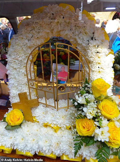 Shown is a floral display on show inside the actor's hearse